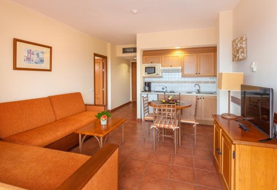 107149-hotel-apartments-isabel---hotel-costa-adeje---adapted-apartment---livingroom-and-kitchen-area.jpg