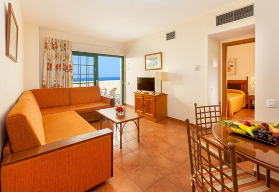 107153-hotel-apartments-isabel---hotel-costa-adeje---livingroom-and-kitchen-area.jpg