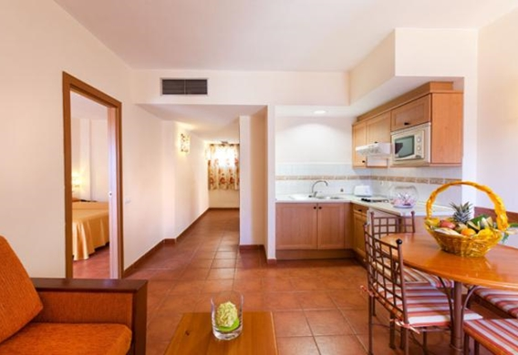 107155-hotel-apartments-isabel---hotel-costa-adeje---adapteed-room---livingroom-and-kitchen-area.jpg