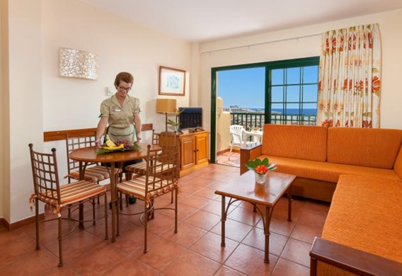 128418-hotel-apartments-isabel---hotel-costa-adeje---adapted-apartment---livingroom-and-kitchen-area.jpg